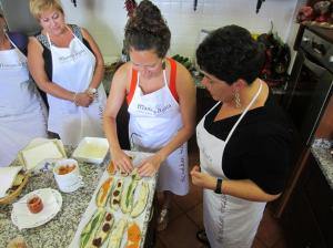 Learning how to roll Eggplant Rolls with Chiara, Mamma Agata's daughter.